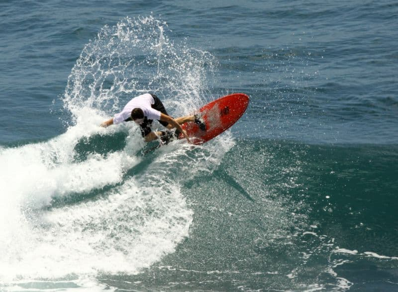 Me on my first day surfing at Uluwatu, trying to do a turn off the top.