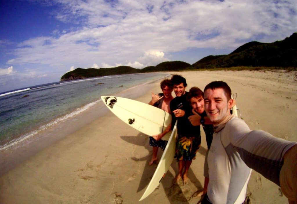surfers looking at a camera