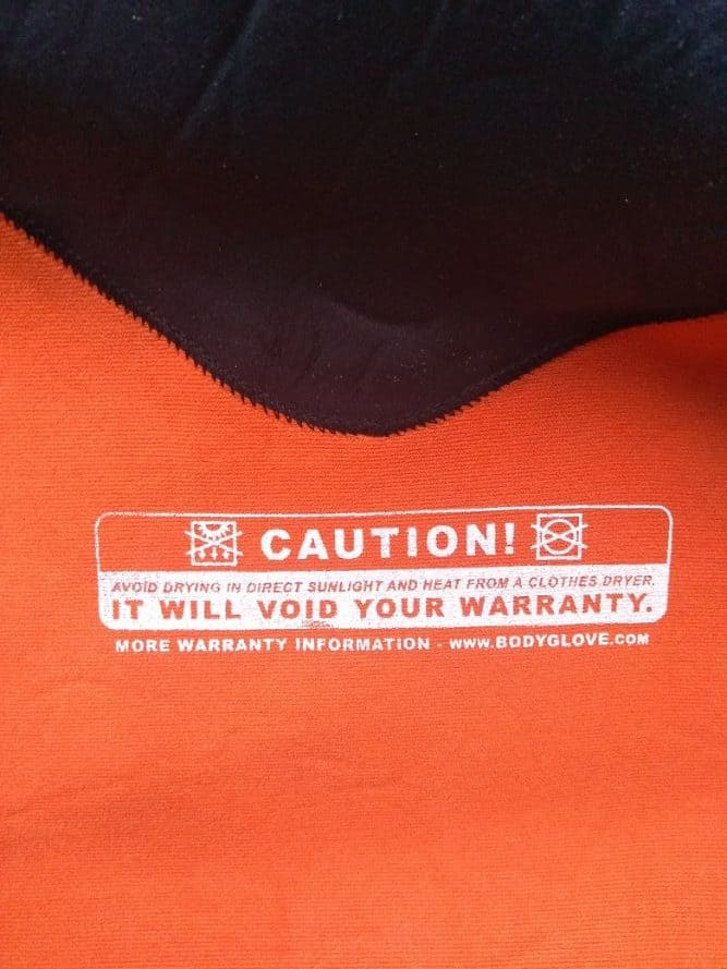 label inside a wetsuit warning not to spin dry it